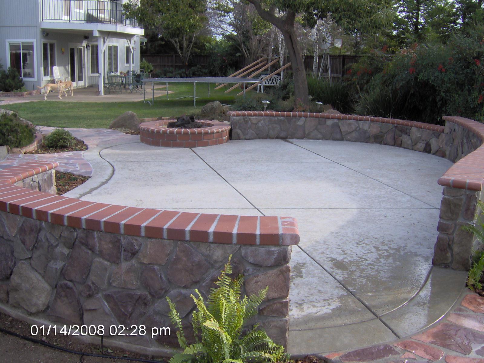 Concrete patio brick wall modern patio outdoor for Brick wall patio designs
